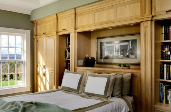 Traditional bedroom featuring a full wall of wooden built-ins