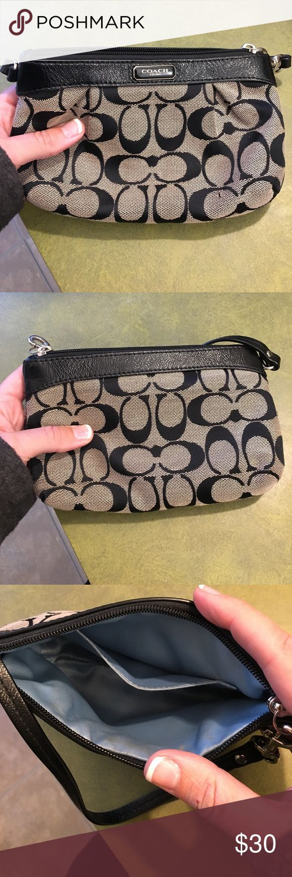 Coach clutch: black and grey Coach clutch in great condition.  Has a strap so it can be worn as a wristlet.  Minimally used. Coach Bags Clutches & Wristlets