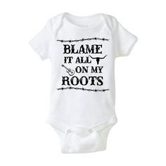 """This baby bodysuit/ onesie is an image the phrase """"Blame it all on my roots,"""" which is in the country music song Friends in Low Places by Garth Brooks. This onesie is perfect for new babies and parents. This onesie is perfect for babies with parents who love country and western music or hang out in the Southern states....the guns and gardens crowd who have recently procreated. This makes an awesome baby gift for parents and babies. It makes a cool gift for a baby shower."""