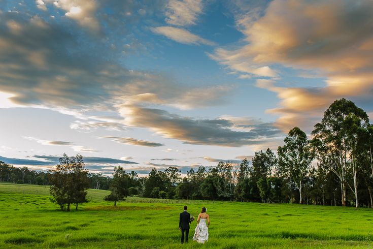Bride & Groom among the lush green grounds of Mindaribba House, Hunter Valley wedding venue | PHOTO CREDIT: Ben Howland - @benhowland