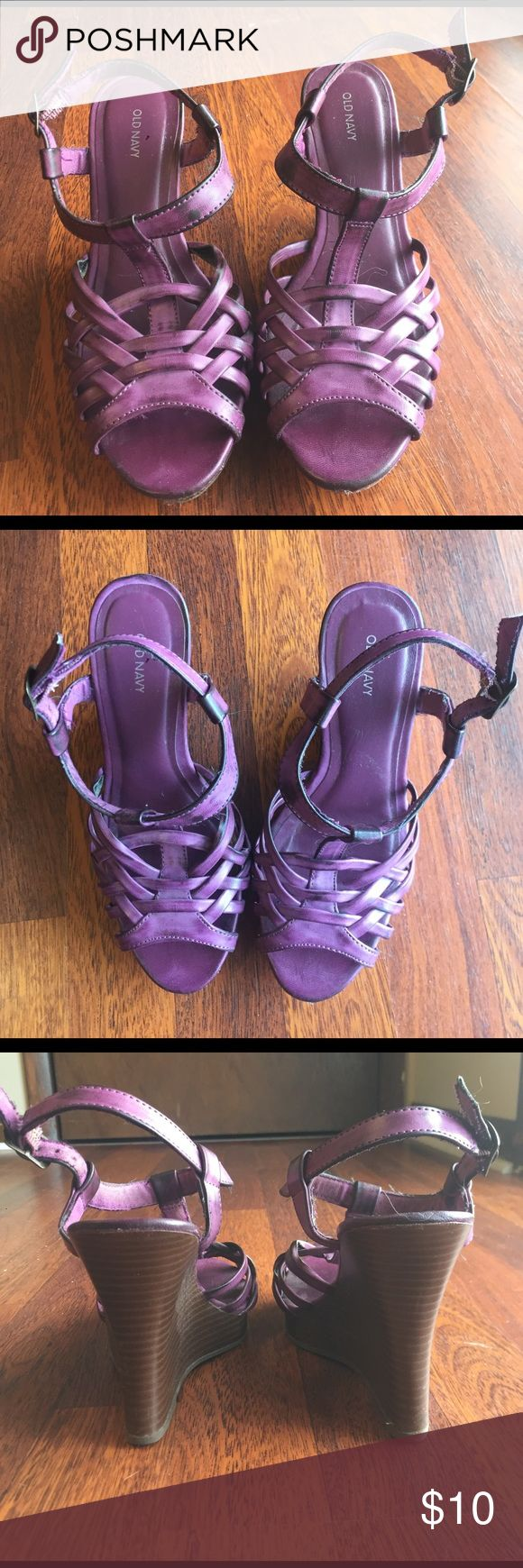 Purple Wedges These adorable purple wedges are a perfect pop of color to any outfit. They are in almost perfect condition despite a little fraying on the strap but they have only been worn about 5 times. Old Navy Shoes Wedges