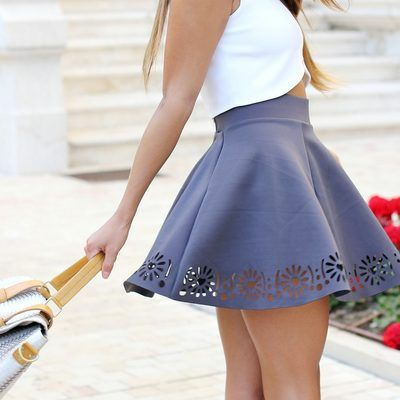 use a stencil and an exacto knife to cut designs out of the bottom of skirts or shirts