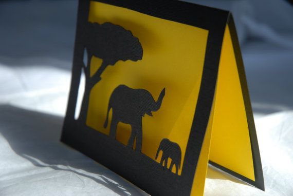 This is a wonderful card, ideal to give to any person who loves elephants, the bush or Africa. The card is made for any occasion, like thank you, happy birthday or thinking of you.   The print is drawn and hand-cut by me.   Inside the card is a yellow paper, representing the sunset.