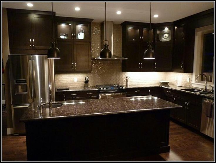 Wow... this whole kitchen just works. The back splash and the stainless steel look good together.