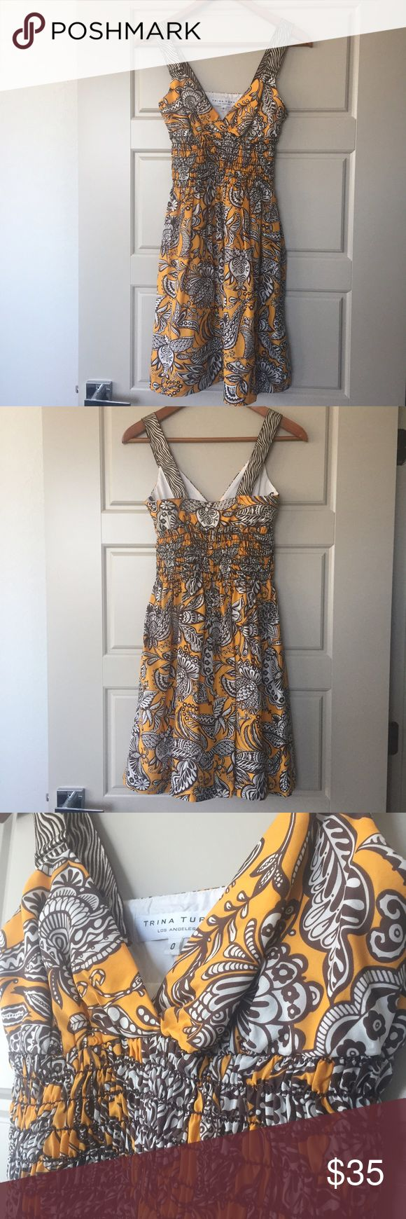 TRINA TURK Dress, Size 0 TRINA TURK Dress, Size 0. Fun bright yellow pattern with front V-neck design; side zipper closure. Excellent condition. Trina Turk Dresses
