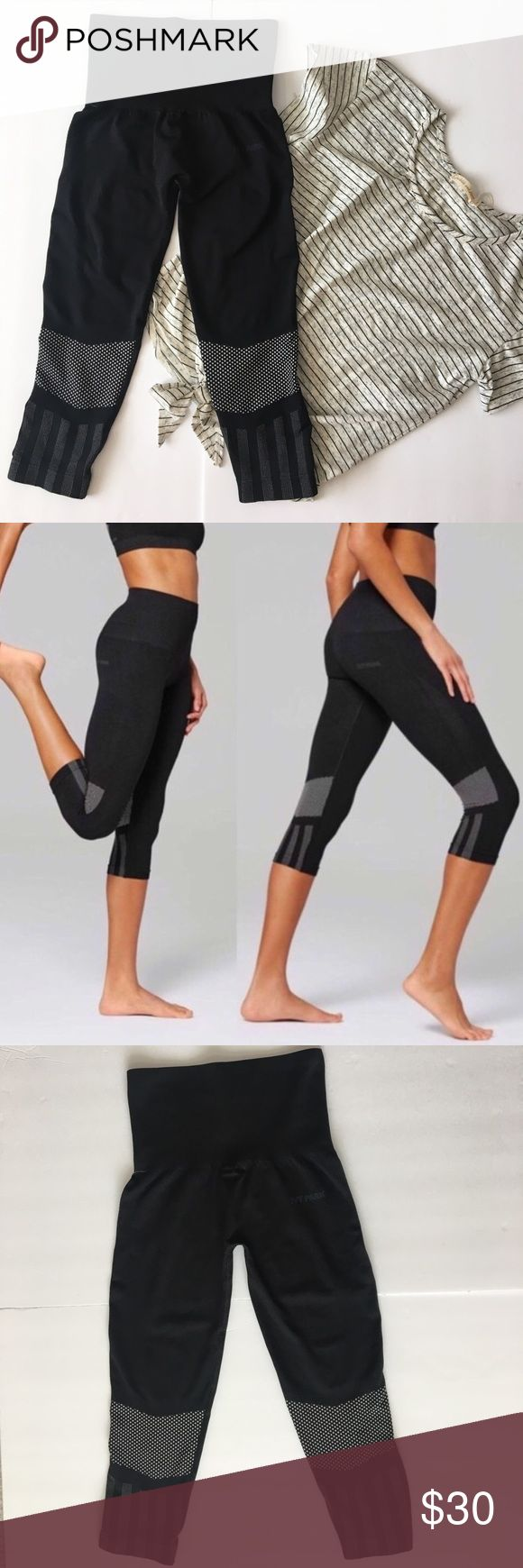 New Ivy Park Black Leggings Size: 0-2 New Without Tags! Super Comfy! Capri-length leggings with ventilating knit mesh at the knees are made from a technical stretch fabric with sweat-wicking and quick-drying properties, making them optimal for both high- and low-impact workouts. A compression-ribbed waist supports and conforms to the body and can be folded down for a low-rise fit that reveals a stripe accent. Size: XXS/XS 0-2 Elastic waistband. Logo at back waist. 72% polyester, 24% nylon…