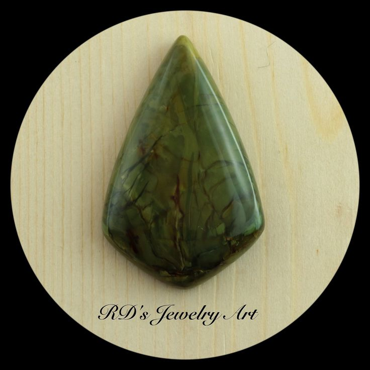 Morrisonite Cab by Ardith.  42.5mm x 26.8mm x 6.4mm  Natural hand cut stone, polished back, Girdle angles in slightly towards the top dome making it great for a tight bezel fit or wire wrapping.  $40.00USD + Shipping (from Canada)