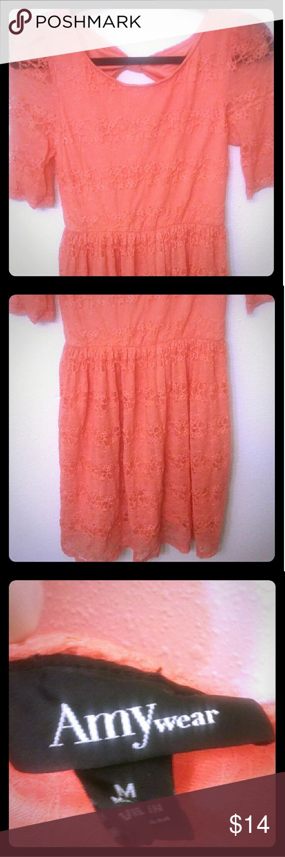 Amy Wear neon coral lace dress Amy Wear neon coral lace dress. Back has cutout with a bow. All lace overlay, gently used. No snags, stains, or holes. Dresses Mini
