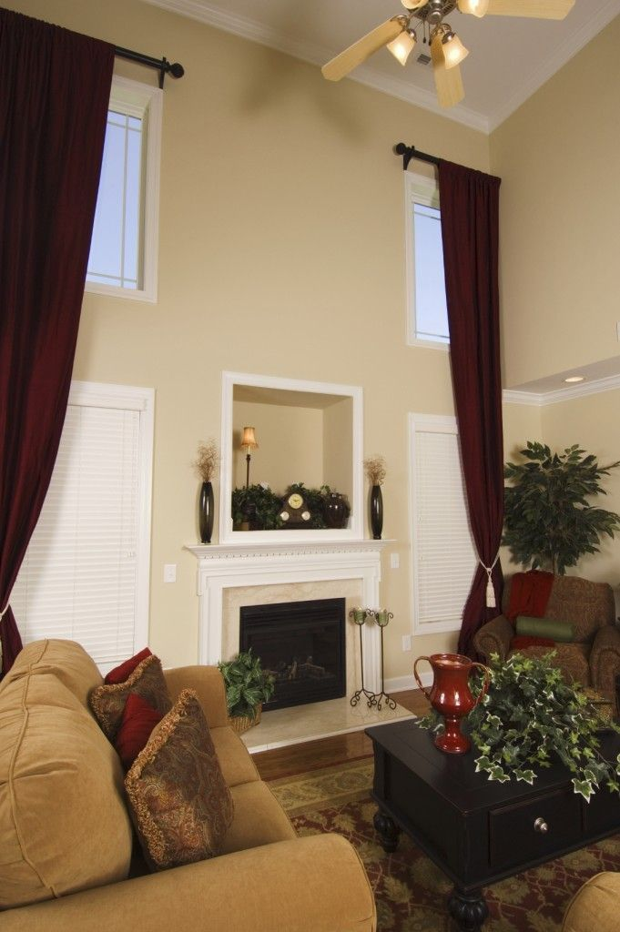 In A Two Story Great Room Curtains Can Be Used To Frame An Entire Wall With Layers Of Wind Family Room Curtains Long Curtains Living Room Curtains Living Room