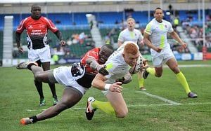 England's James Rodwell strains for the line during a 2013 rugby sevens tournament