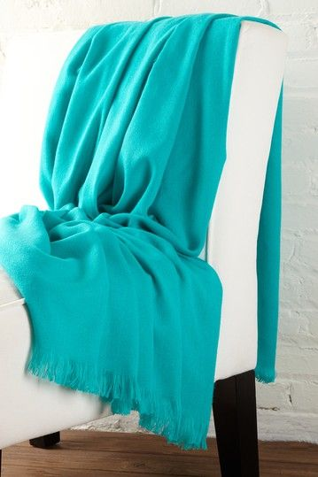 A cashmere throw, how luxurious.  And I love the aqua color.  It would pop my brown sofa.