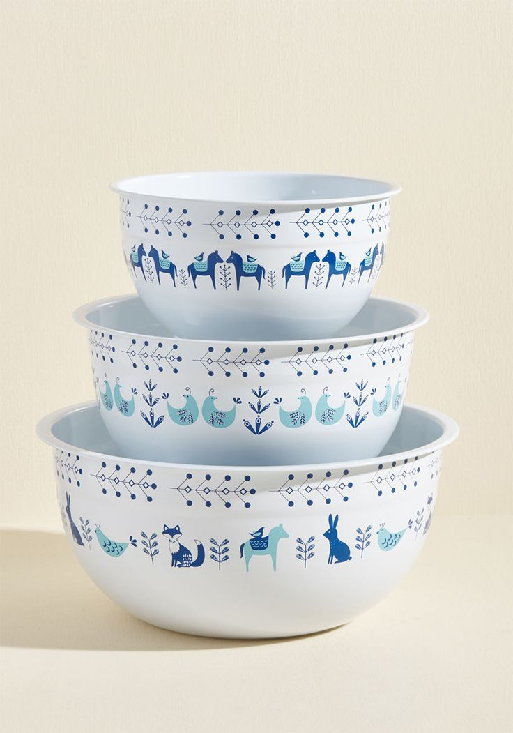 <p>Recipes aren't the only way you like to get crafty in the kitchen - using these white enamel mixing and serving bowls are another creative outlet, as well! A trio of nesting vessels all with sky-and-navy blue Scandinavian patterns featuring horses, partridges, and bunnies, this collection is a way-cute couter top expression.</p>