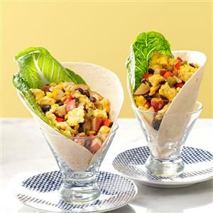 Dad's Ultimate Breakfast Burritos Recipe -A dad-pleasing day is guaranteed when these breakfast burritos are on the menu. He'll love the peppery eggs mixed with potatoes, onions, corn, beans and seasonings in an overstuffed tortilla and smothered in cheese.—Stacey Nerness, Spencer, Iowa