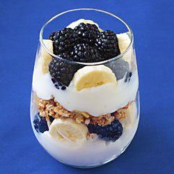 Breakfast Parfait - fruit, yogurt, and granola looks so pretty in a stemless wine glass