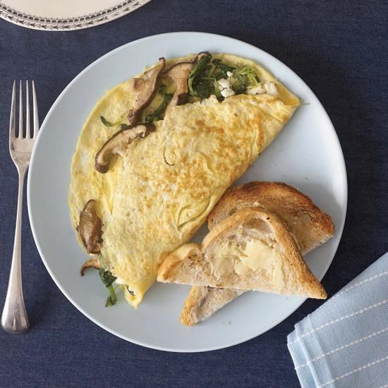 Wild Mushroom and Goat Cheese Omelets | The idea for this creamy-tangy omelet comes from a fish dish often on the dinner menu at Grace Restaurant that includes some of the same ingredients here: shiitake mushrooms and delicate fresh pea shoots.