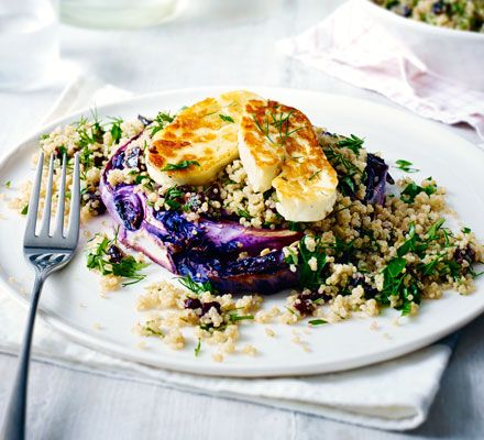 Thickly sliced wedges of roasted cabbage make a satisfying yet easy vegetarian dinner - served on a bed of herby, zesty quinoa.