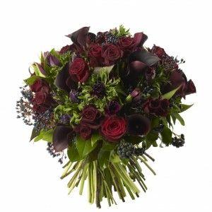 Black Calla Lilys, Purple Anemones, Dark Purple Tulips, Black Bacarra Roses and Berried Ivy.