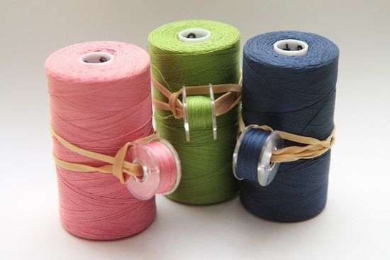 Bobbin organization - clever way to keep thread and bobbins together.