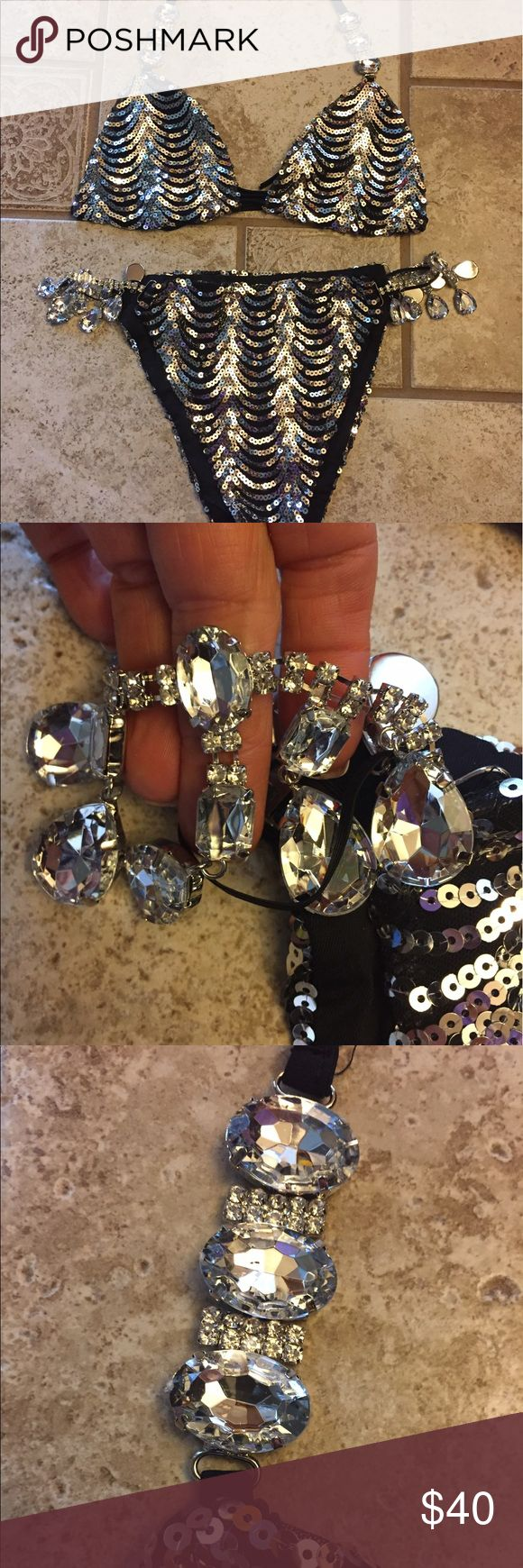 New rhinestone and sequin bikini set Brand new ordered online. Came wrapped in plastic bag. No brand tag.  Black with silver sequins and nice big rhinestone accents for the sides of the bikini bottoms and matching stones on the top.   I bought this for another Mexico trip that didn't take place. Very nice / sexy set. Both pieces ate medium and smoke free Swim Bikinis