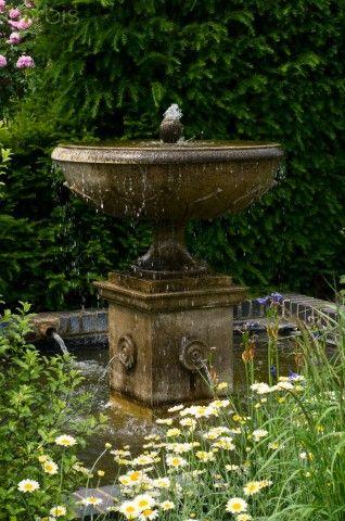 classical fountain in garden