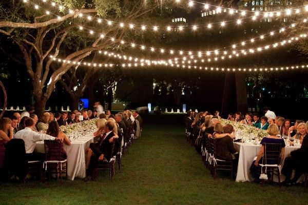 String lights hung from trees provide a romantic glow for outdoor wedding venues