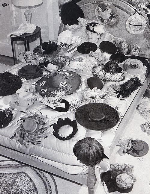 Synonymous with fabulous hats: The gossip columnist of the Golden Age of Hollywood: Hedda Hopper snuggling up with a few of her hats.