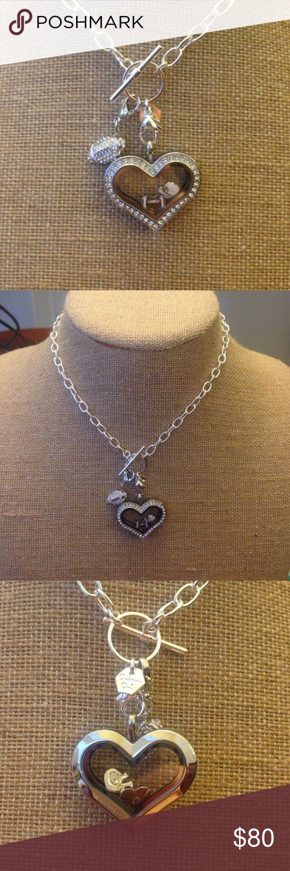 "Origami Owl Football Heart Locket NWT. 100% authentic. Includes crystal heart locket, 16"" toggle chain, 2 charms (football heart, football helmet), and a crystal football dangle. I have 2 of these for sale!! Each one retails for $100 Origami Owl Jewelry Necklaces"