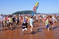 Let's take a run on the ocean floor - The Not Since Moses Race on the Bay of Fundy at low tide.