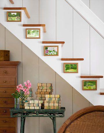 Postcards framed along a stair