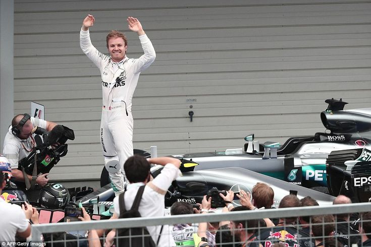 Nico Rosberg stands on top of his Mercedes after cruising to win the Japanese Grand Prix and extend his championship lead