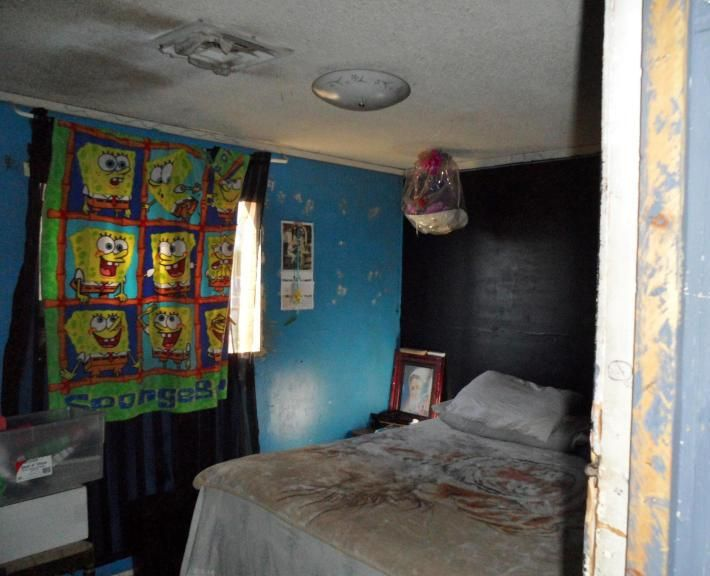 cheap inexpensive street corner blanket SpongeBob SquarePants used as window curtain drape bedroom Phoenix Arizona home house for sale