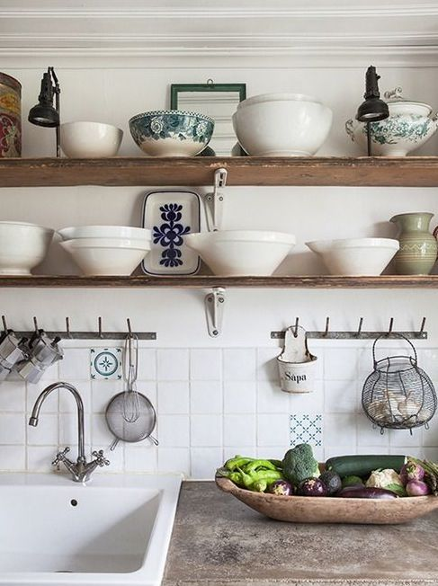 Recycled board make great shelves. Like the rustic concrete countertop also and the butler sink.                                                                                                                                                                                 More