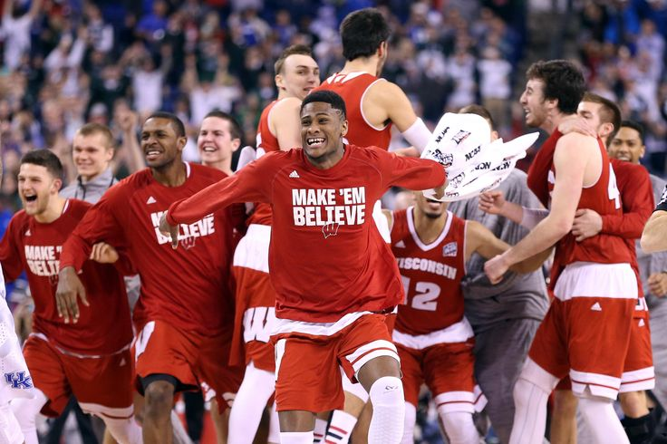 Vitto Brown #30 of the Wisconsin Badgers celebrates with teammates after defeating the Kentucky Wildcats during the NCAA Men's Final Four Semifinal.