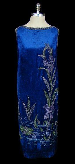 Evening Dress: ca. 1920's, silk velvet, beads surrounding neckline and armscyes, extensive exotic flowery beading.
