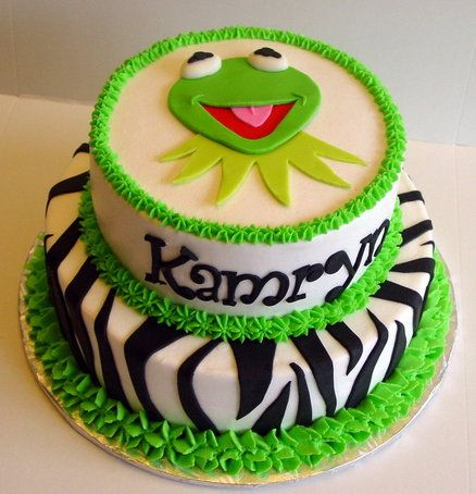 I like Kermit on top, but maybe with the Ice Cream cake pin - Lollipops & Ice Cream Candyland Cake!