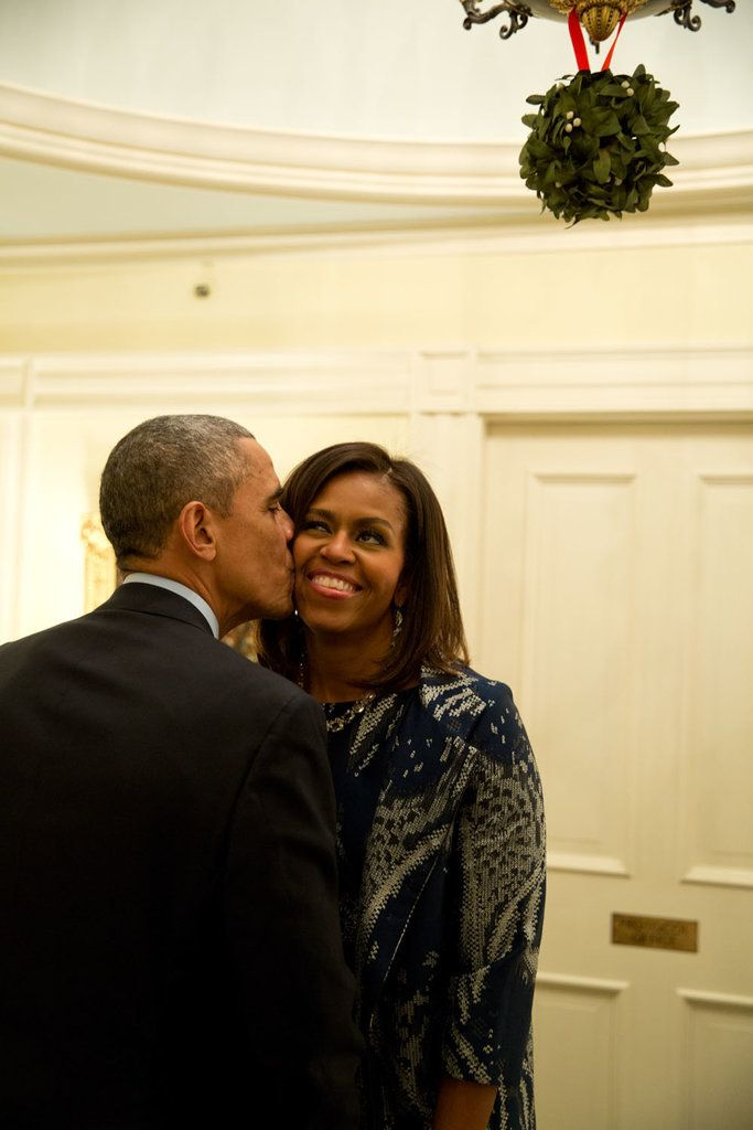 Barack and Michelle Obama share a sweet moment in 2014.