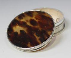 Silver and tortoiseshell compact