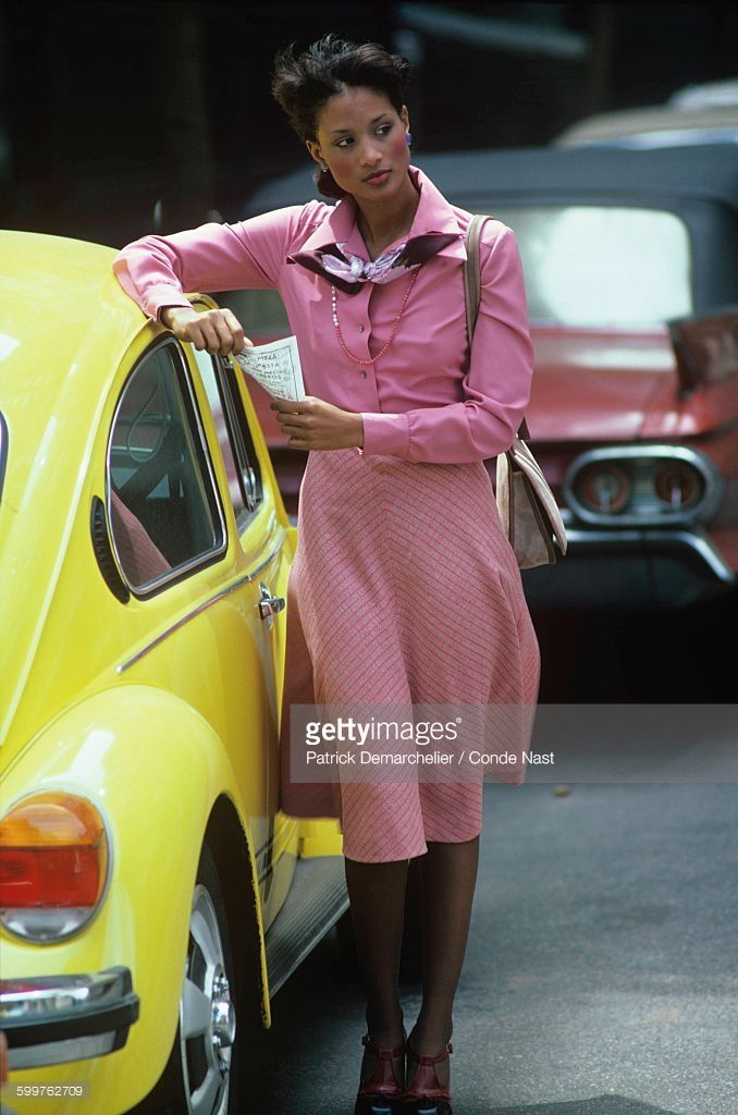 News Photo : Model Beverly Johnson leaning against a yellow...