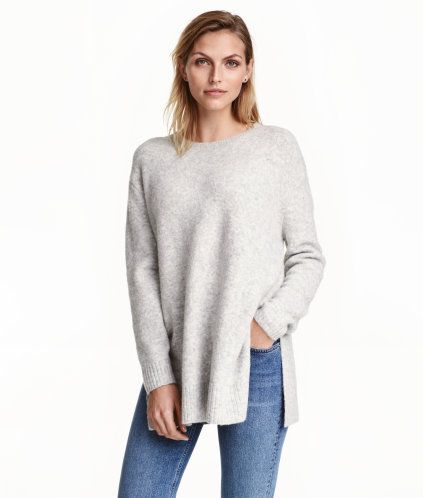Beige melange. Oversized sweater in a melange knit with wool content. Round neck, dropped shoulders, long sleeves, and slits at sides.