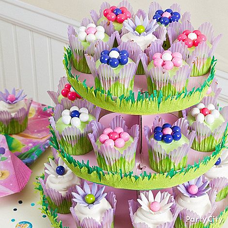 Lil' girls love dainty foods like fairy cupcakes decorated with Sixlets and edible petals. Click the pic for more Tinker Bell party ideas!