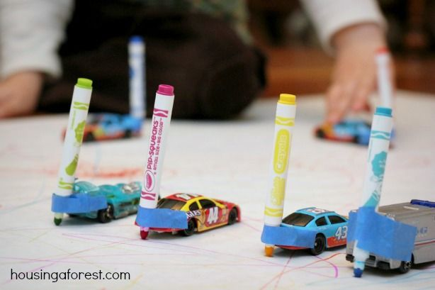 taped markers on the bumper of the kids cars, making sure the marker tip was even with the wheels. That's it. The cars are all lined up an...