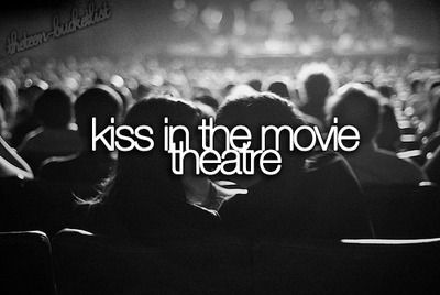 Kiss in the movie theatre. ()