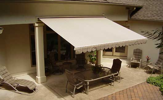 Retractable awning for an outdoor patio window - Motorized exterior window shades ...