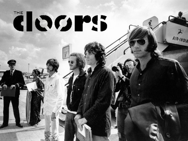 Ray Manzarek (far right) stands with fellow members of The Doors Jim Morrison (from right) Robby Krieger and John Densmore in Manzarek died Monday in ...