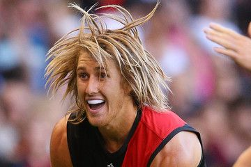There is one reason why I would invite Dyson Heppell, Essendon star, to a dinner party: so everyone could admire his wonderful hair.