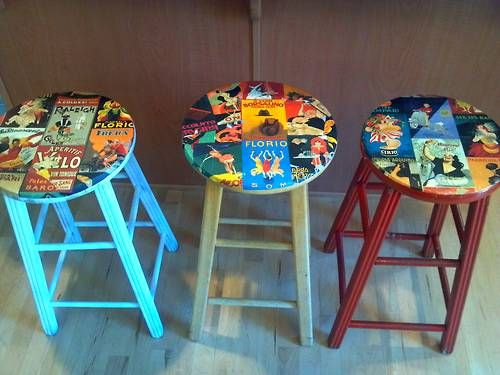 Make resale or thrift store stools into matched set. Decoupage just the seats in something meaningful to you, then paint the rest in colors pulled out from the artwork.