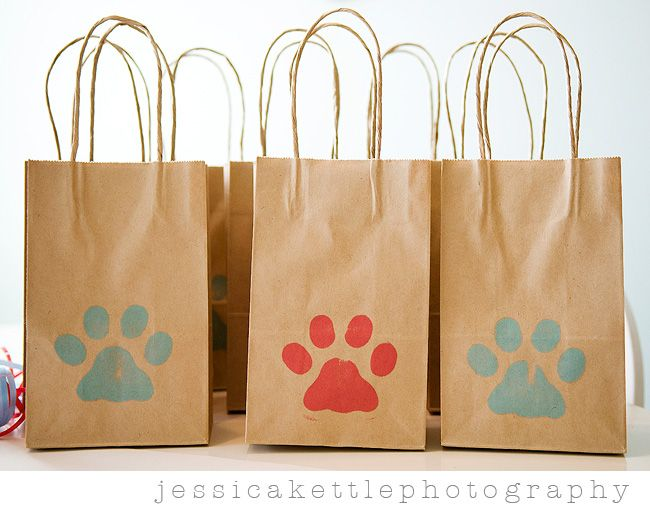 Puppy themed birthday party paw print favor bags