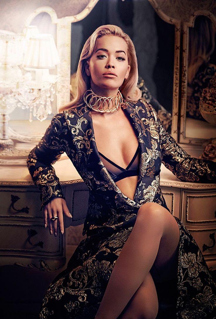Rita Ora shines in Dolce & Gabbana coat, Tezenis bra, Loewe necklace and Louis Vuitton ring