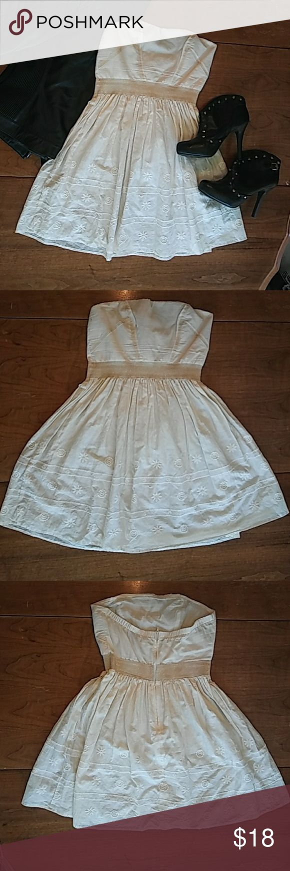 Kouture summer dress Sweet cream summer dress with gold detailing and embroidered flowers on the bottom by Kouture by Kimora. Size Large juniors bust measures 15.5in.laying flat waist measures 13.5in. Laying flat with a quite a bit of give due to the elastic waist. Length from top to bottom is 28in. Perfect for summer you can dress it up w some booties, tights and a leather jacket (like I did in 1st pic.) Or throw it on w some flip flops a cute bag and youre ready to go! kouture by kimora…
