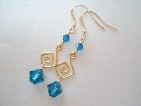 Grecian Swarovski Blue crystal dangly earrings in gold plated brass